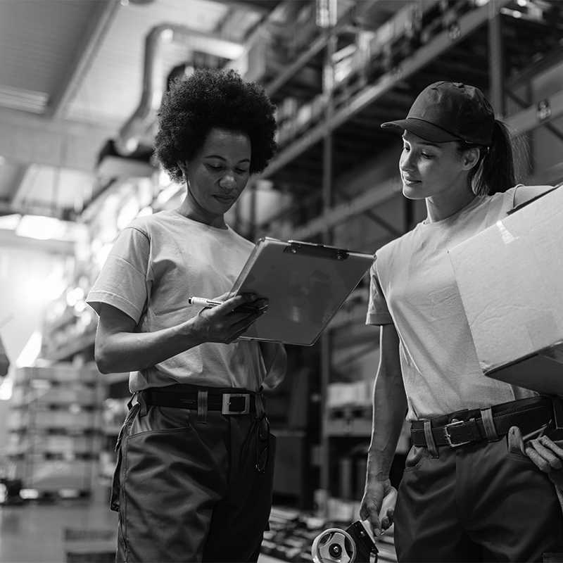 Two female warehouse workers